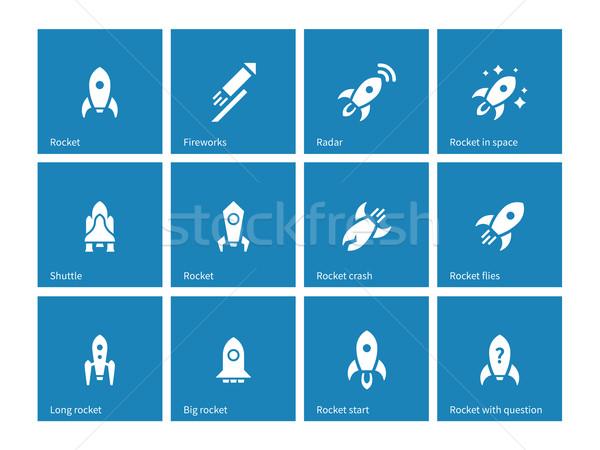 Flat rocket icons on blue background. Stock photo © tkacchuk