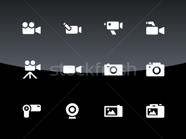Camera icons on black background. Stock photo © tkacchuk