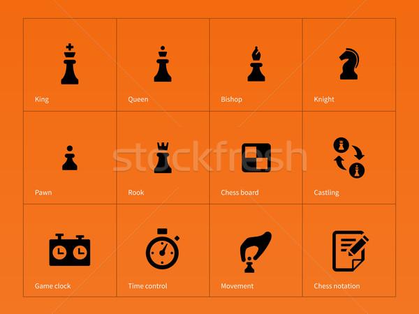 Chess Figures icons on orange background. Stock photo © tkacchuk