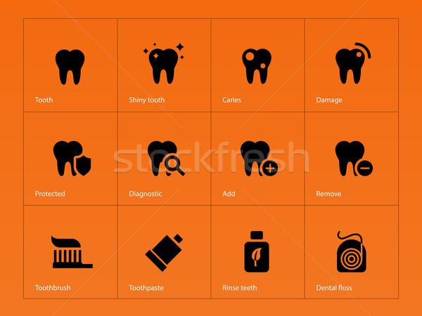 Teeth icons on orange background. Stock photo © tkacchuk