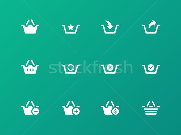 Shopping Basket icons on green background. Stock photo © tkacchuk