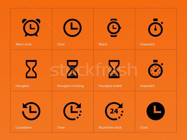 Time and Clock icons on orange background. Stock photo © tkacchuk