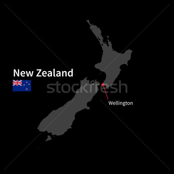 Detailed map of New Zealand and capital city Wellington with flag on black background Stock photo © tkacchuk