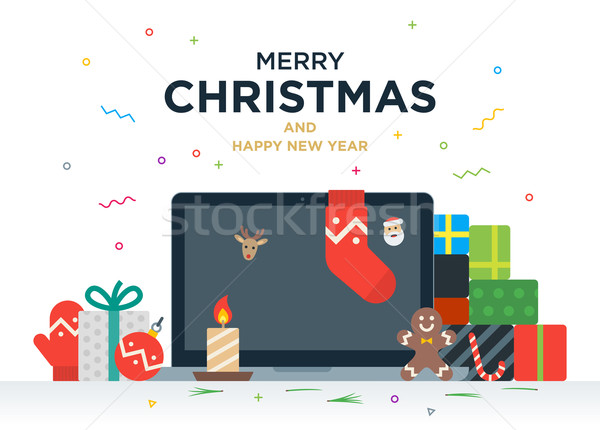 Laptop with gifts, candles, red ball and Christmas socks on the screen Stock photo © tkacchuk