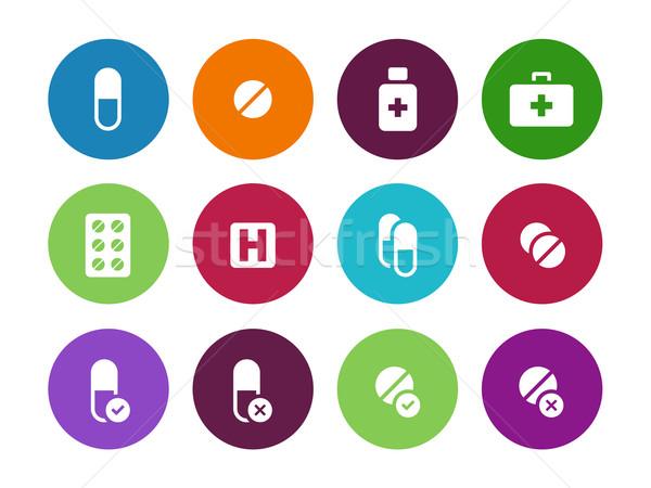 Pills, medication circle icons on white background. Stock photo © tkacchuk
