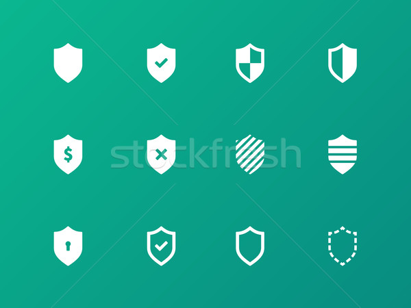 Shield icons on green background. Stock photo © tkacchuk