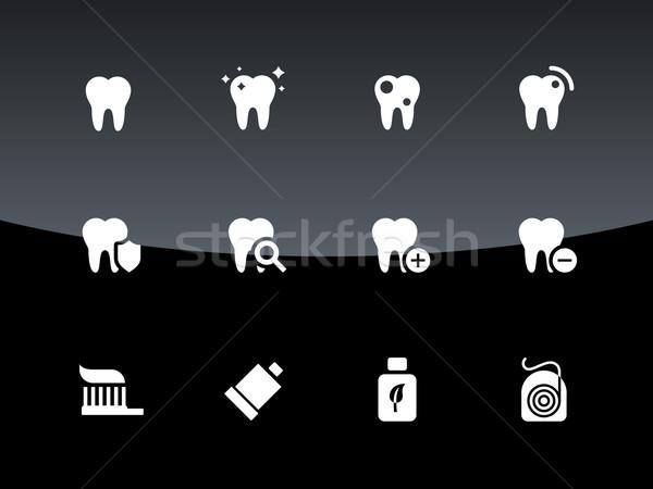 Tooth, teeth icons on black background. Stock photo © tkacchuk