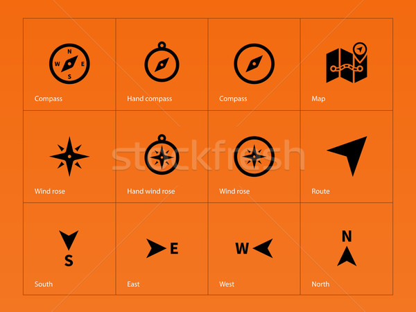 Compass icons on orange background  vector illustration © Vector