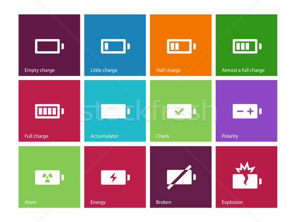 Battery icons on color background. Stock photo © tkacchuk