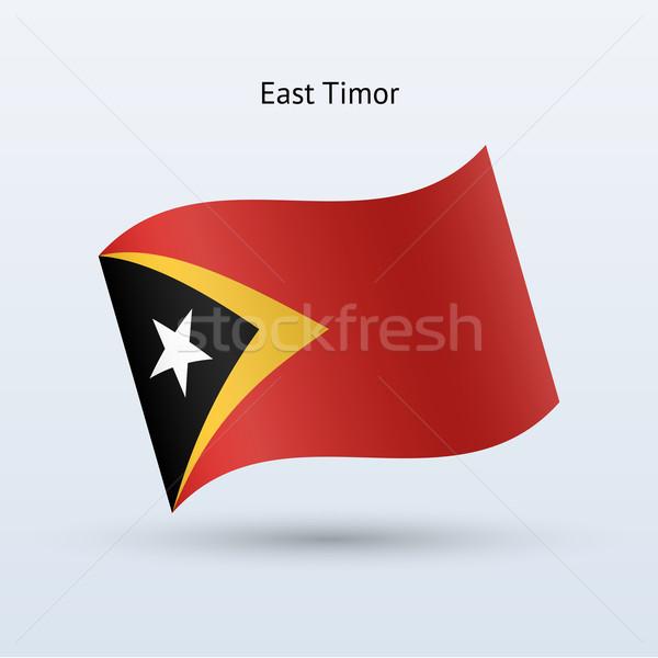 East Timor flag waving form. Vector illustration. Stock photo © tkacchuk