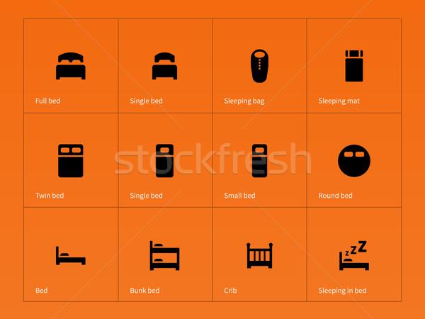 Bed, crib and sleeping bed icons on orange background. Stock photo © tkacchuk