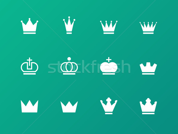 Crown icons on green background. Stock photo © tkacchuk