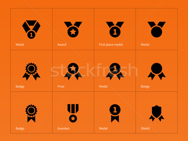 Medal and cup icons on orange background. Stock photo © tkacchuk