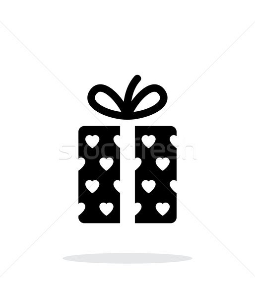 Stock photo: Gift box with hearts icons on white background. Vector illustration.