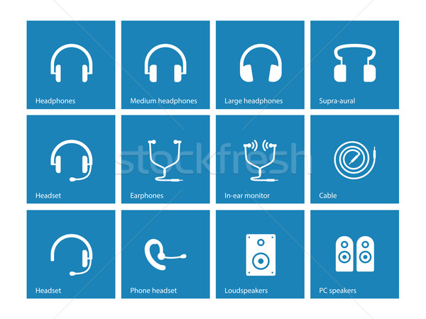 Earphones and speakers icons on blue background. Stock photo © tkacchuk
