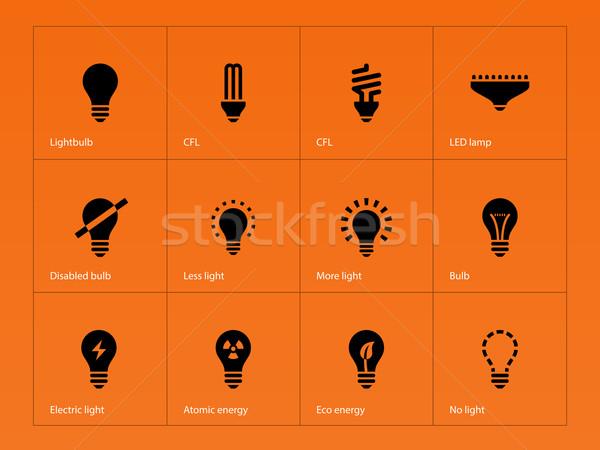 Light bulb lamp icons on orange background. Stock photo © tkacchuk
