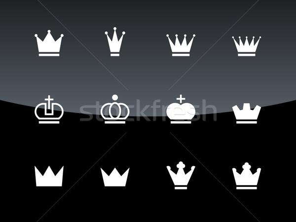 Crown icons on black background. Stock photo © tkacchuk