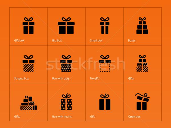 Gift icons on orange background. Stock photo © tkacchuk