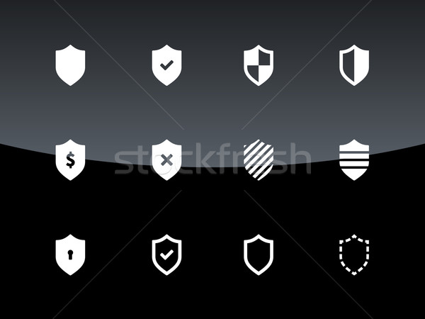 Shield icons on black background. Stock photo © tkacchuk