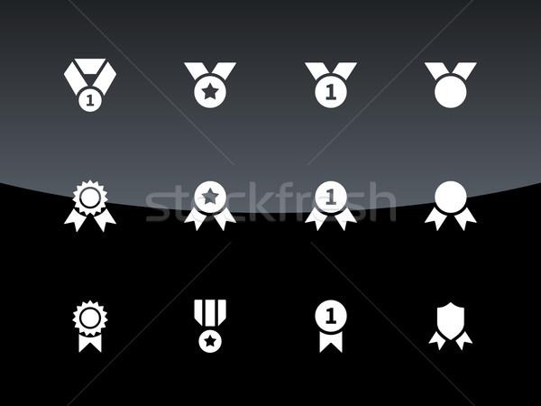 Awards and medal icons on black background. Stock photo © tkacchuk