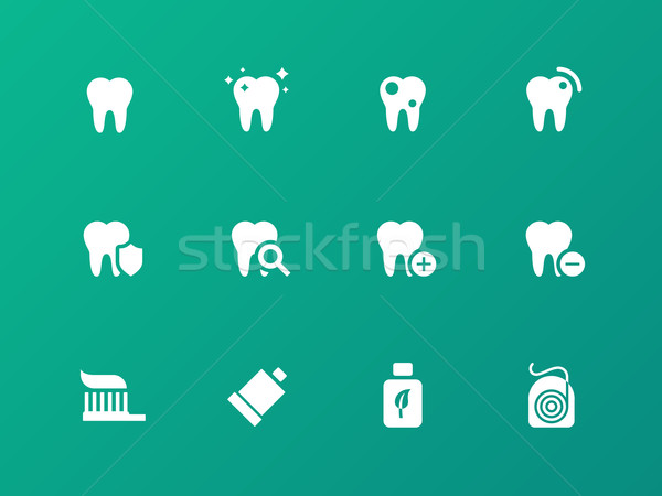Tooth, teeth icons on green background. Stock photo © tkacchuk