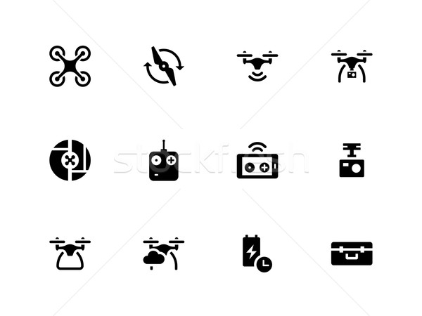 Quadcopter and flying drone icons on white background. Stock photo © tkacchuk