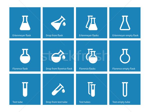 Test tube and flask icons on blue background. Stock photo © tkacchuk