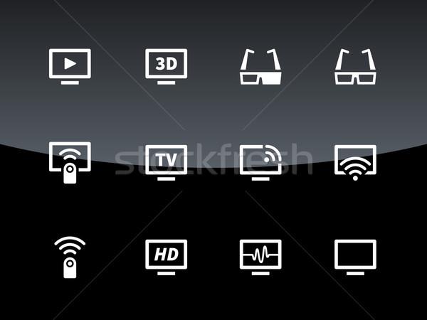 Stock photo: TV icons on black background. Vector illustration.