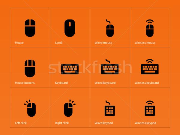 Mouse and keyboard icons on orange background. Stock photo © tkacchuk