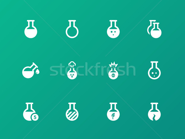 Flacon and flask icons on green background. Stock photo © tkacchuk