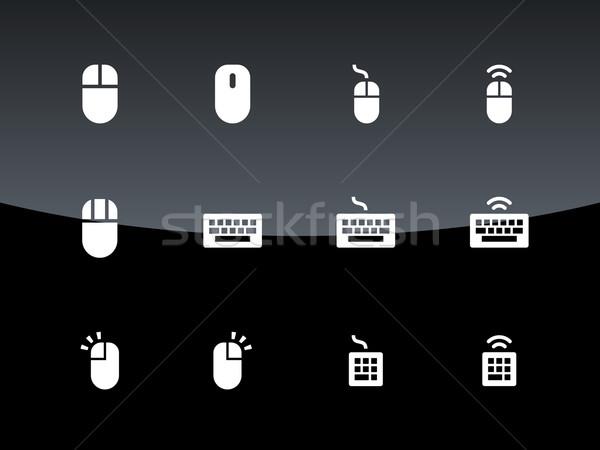 PC mouse and keypad icons on black background. Stock photo © tkacchuk
