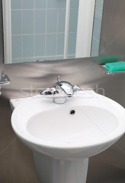 Salle de bain évier acier inoxydable céramique intérieur savon Photo stock © tlorna