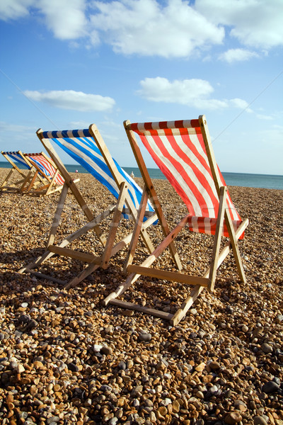 deckchairs beach sea windy Stock photo © tlorna