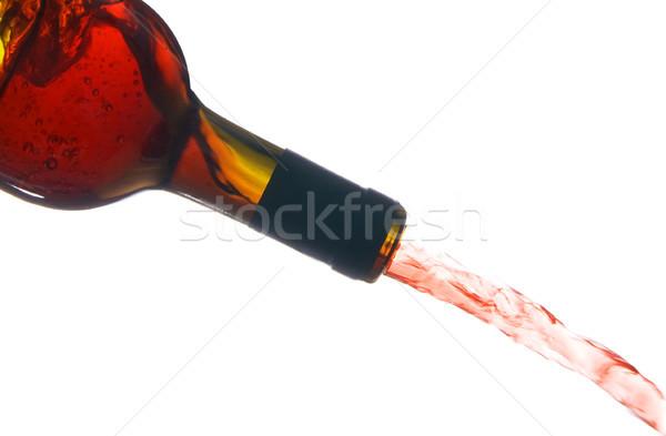 Vin rouge sur bouteille de vin isolé blanche Photo stock © tlorna