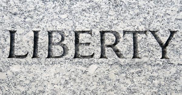 Liberté mot heureux pierre vie marbre Photo stock © tmainiero