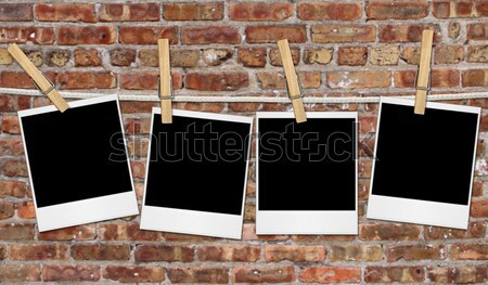 Empty Film Blanks Hanging Against a Grungy Brick Wall Stock photo © tobkatrina