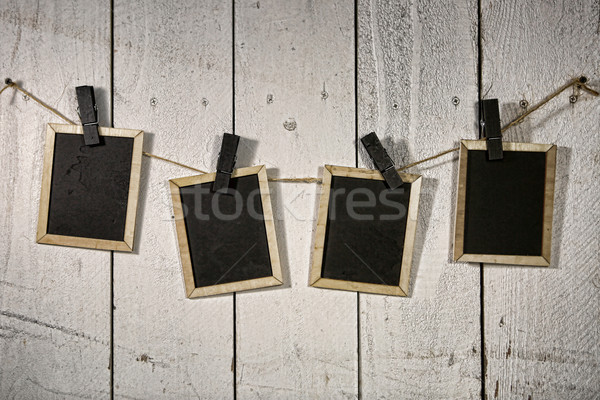 Film Looking Chalkboards Hanging on a Rope Held By Clothespins Stock photo © tobkatrina