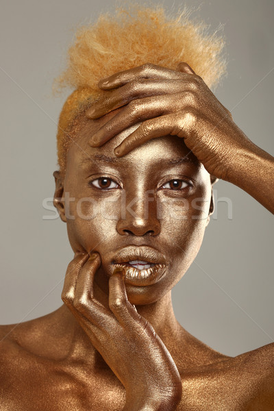 Stunning African Amercian Woman Painted With Gold  Stock photo © tobkatrina