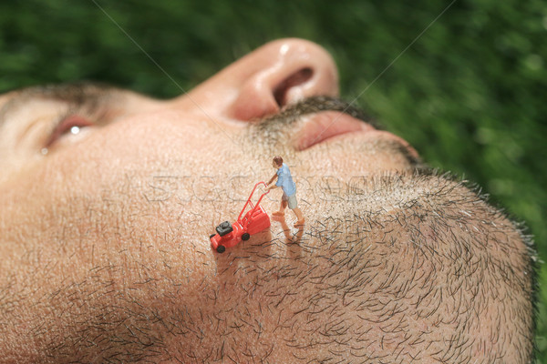 Little People Mowing Hair off a Mans Face Stock photo © tobkatrina