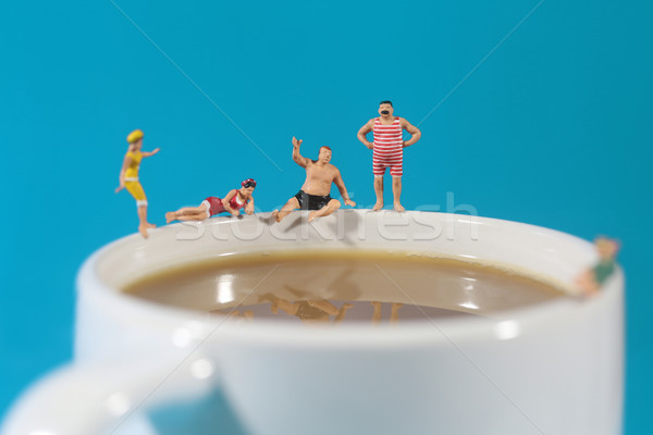 Plastic People Swimming in Coffee Stock photo © tobkatrina