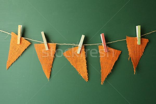 Burlap Pennants Hanging on a Green Chalkboard Stock photo © tobkatrina