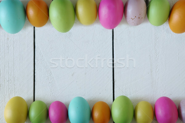 Easter or Spring Themed Background of Old Wood and Colored Eggs  Stock photo © tobkatrina