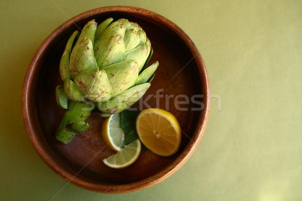 Artichoke in Wooden Bowl With Lemons Stock photo © tobkatrina