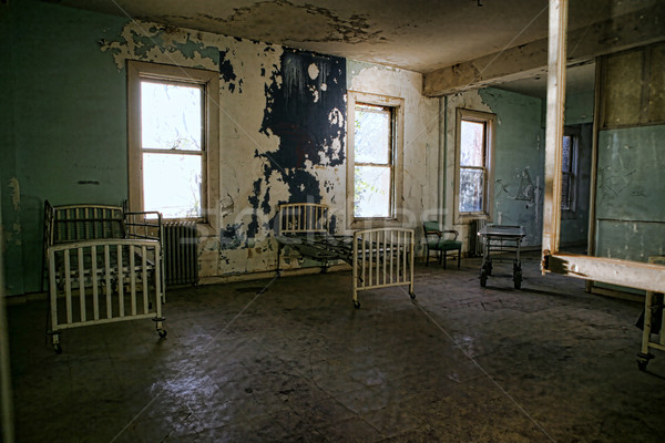 Delapidated Hospital Building With Empty Rusted Beds Stock photo © tobkatrina