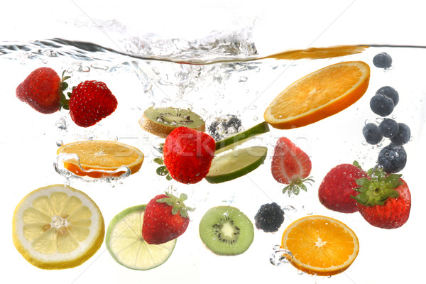 Fruits Falling Into Splashing Clear Water Stock photo © tobkatrina