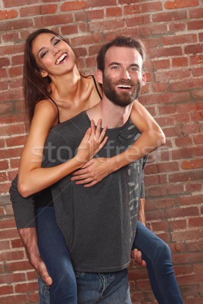 Happy Couple Piggybacking his Beautiful Girlfriend Stock photo © tobkatrina