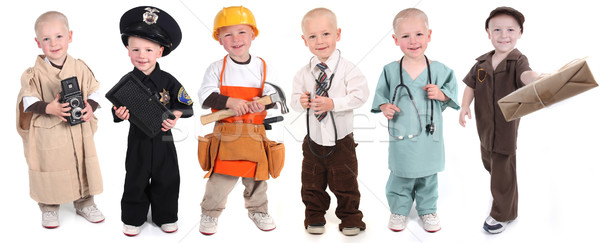 Boy Wearing Various Occupational Uniforms Stock photo © tobkatrina