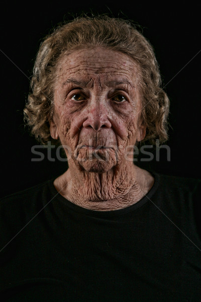 Elderly Old Woman on Black Background Stock photo © tobkatrina