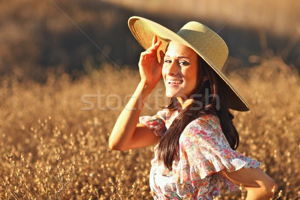 Young Beautiful Woman on a Field in Summer Time Stock photo © tobkatrina