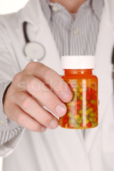 Doctor With Medication in Prescription Bottles Stock photo © tobkatrina